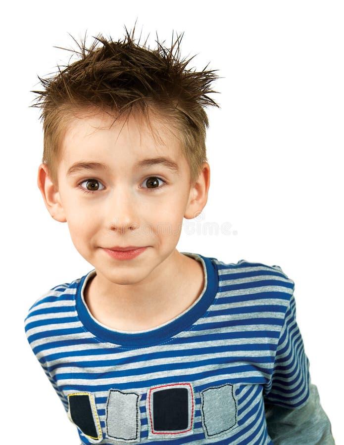 Verraste glimlachende jongen royalty-vrije stock afbeeldingen
