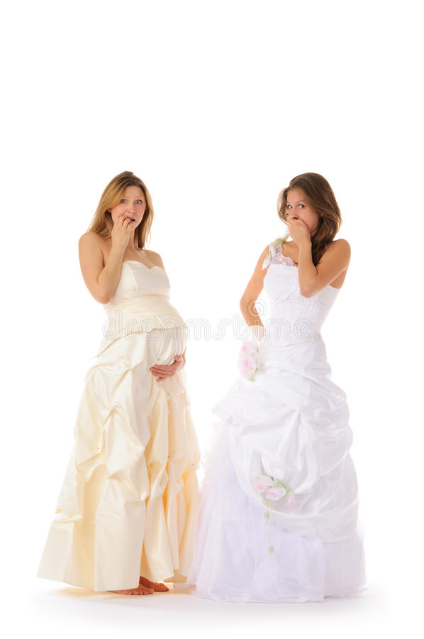 Verraste zwangere bruid met zijn meisje stock foto