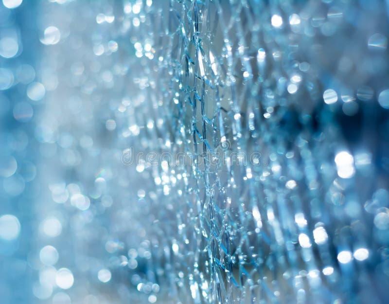 Verre cassé bleu avec la texture d'effet de bokeh photo libre de droits
