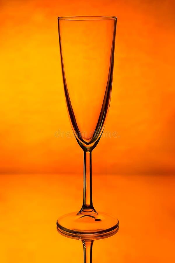 Download Verre De Champagne Sur Le Fond Orange Comme La Partie Image stock - Image du glaces, anniversaire: 87702055
