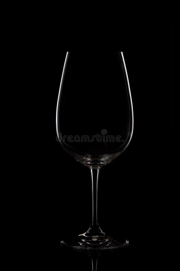 Verre de vin vide sur le fond foncé photos stock