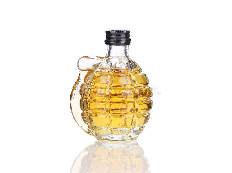 Verre de whiskey avec la grenade photo stock