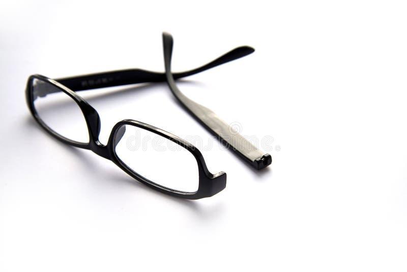 Verres cassés d'oeil, d'isolement sur blanc avec de vraies ombres image libre de droits