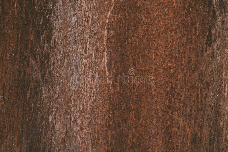 Verrostete Metallbeschaffenheit und -hintergrund Dunkles getragenes rostiges Metall lizenzfreies stockbild