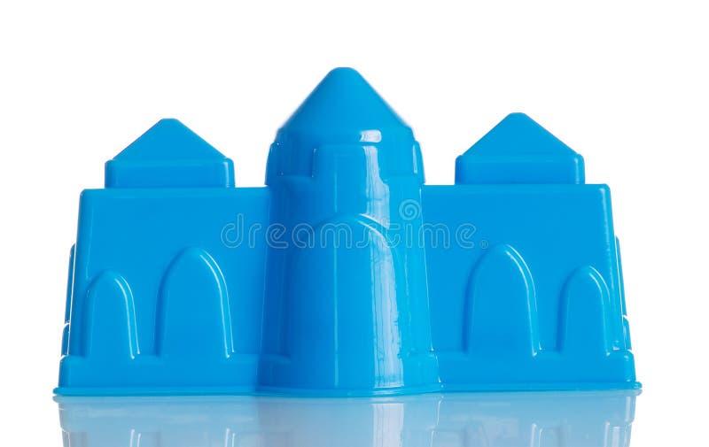 Verrouillage en plastique bleu pour le bac à sable d'isolement sur le blanc photographie stock libre de droits
