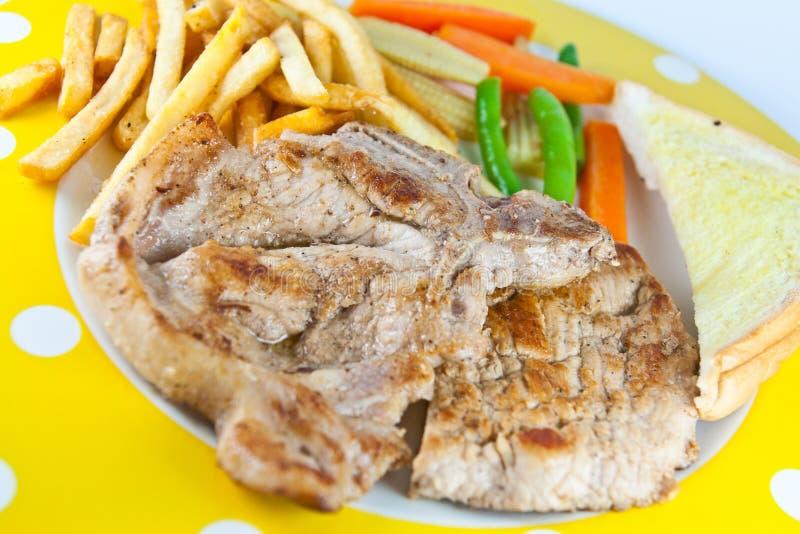 Vers lapje vlees met aardappels royalty-vrije stock foto