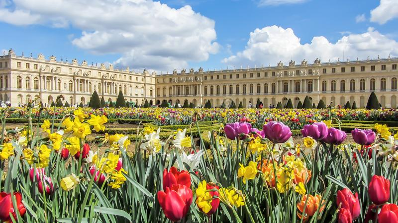 Versailles, France - April, 2012: Gardens of the Versailles in Spring time with colorfu flowers, Palace near Paris, France. royalty free stock image
