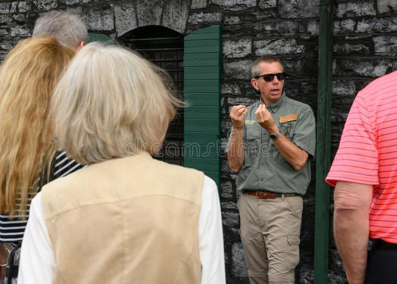 Guide Tells Story of Buffalo Trace on Distillery Tour. Versailles, United States: May 2, 2019: Guide Tells Story of Buffalo Trace on Distillery Tour stock photo