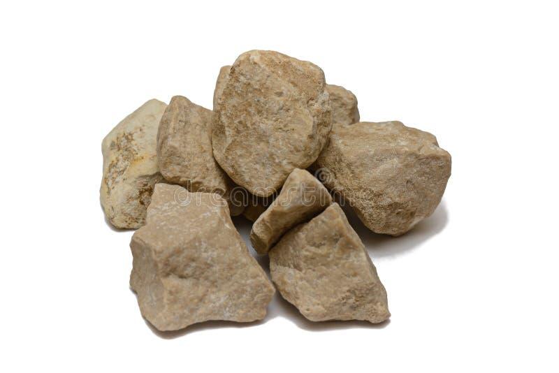 verscheidene lichte stenen op witte achtergrond stock afbeeldingen