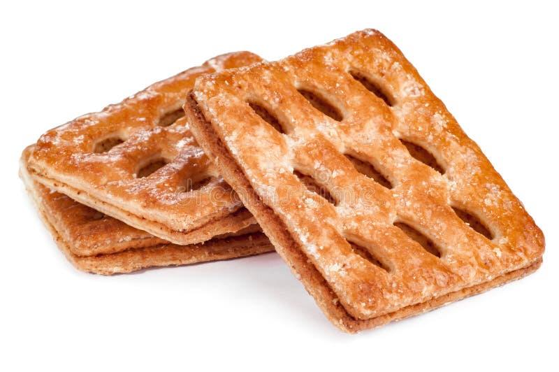 Verscheidene smakelijke die koekjes op witte achtergrond worden geïsoleerd stock afbeelding