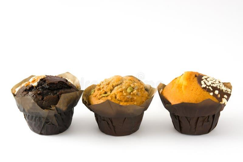 Verscheidenheid van muffins op witte achtergrond wordt geïsoleerd die royalty-vrije stock foto