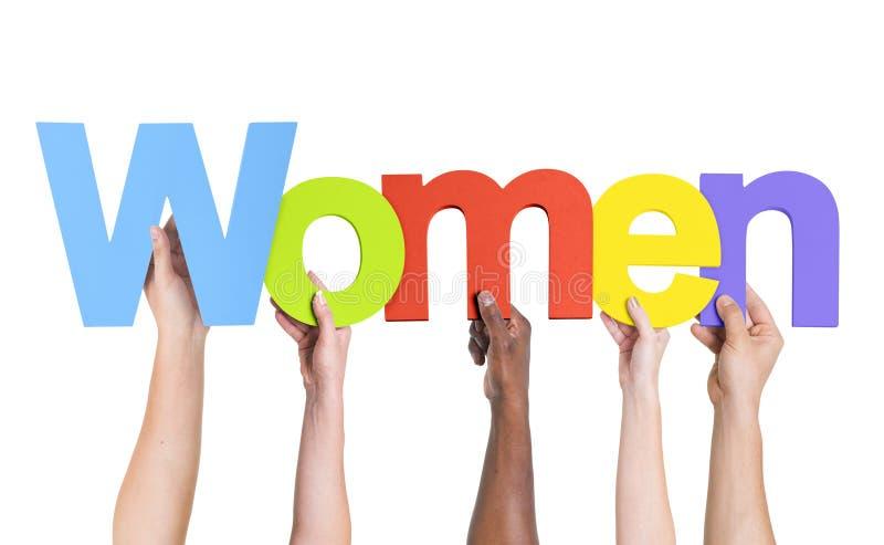 Verschiedene Hände, welche die Wort-Frauen halten lizenzfreies stockbild