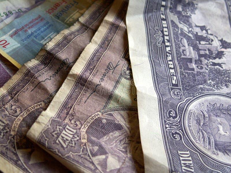 Verschiedenes Bargeld: Venezuela und die Schweiz lizenzfreies stockfoto