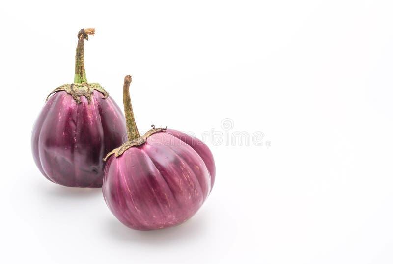 Verse aubergine op wit stock afbeelding