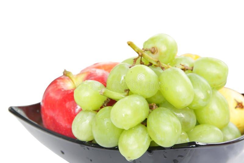 Verse en gezonde vruchten die in kom worden gehouden royalty-vrije stock foto
