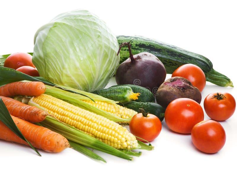 Verse groenten die over wit worden geïsoleerd stock foto's