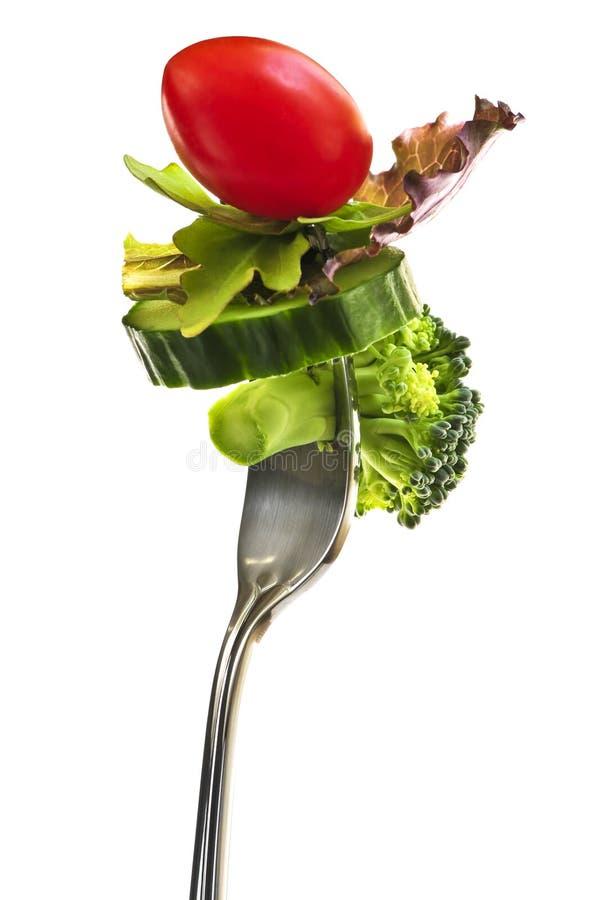 Verse groenten op een vork royalty-vrije stock afbeelding
