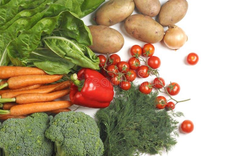 Verse groenten op een witte achtergrond stock afbeeldingen