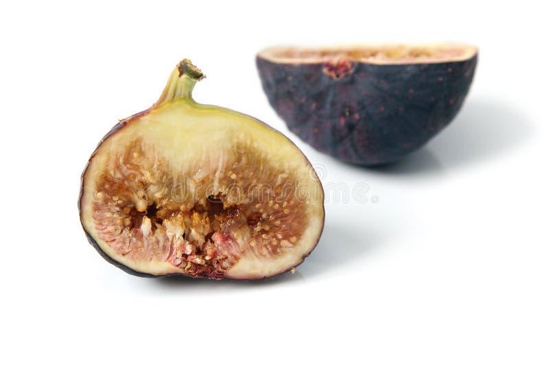 Verse rijpe gemeenschappelijke fig.besnoeiing door om het vlees en de zaden te tonen royalty-vrije stock foto's