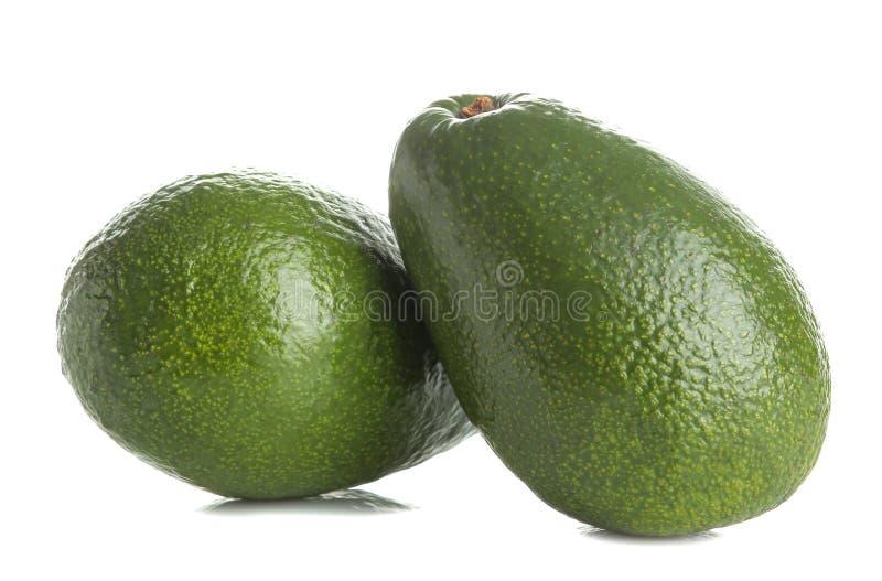 Verse rijpe smakelijke avocado op wit geïsoleerde achtergrond tropisch fruitclose-up stock afbeeldingen