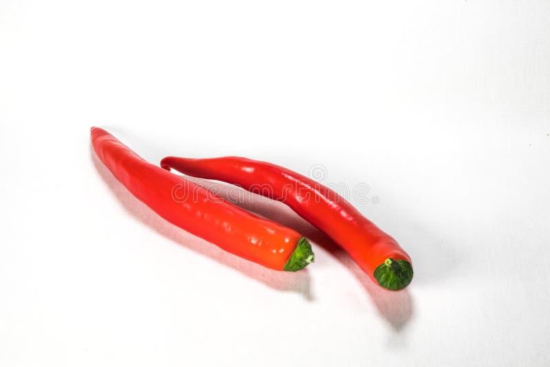 Verse Rode Chilis op een witte Achtergrond stock foto