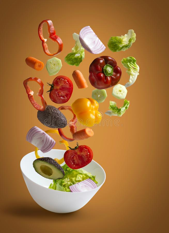Verse saladegroenten met warme achtergrondafbeelding royalty-vrije stock afbeeldingen