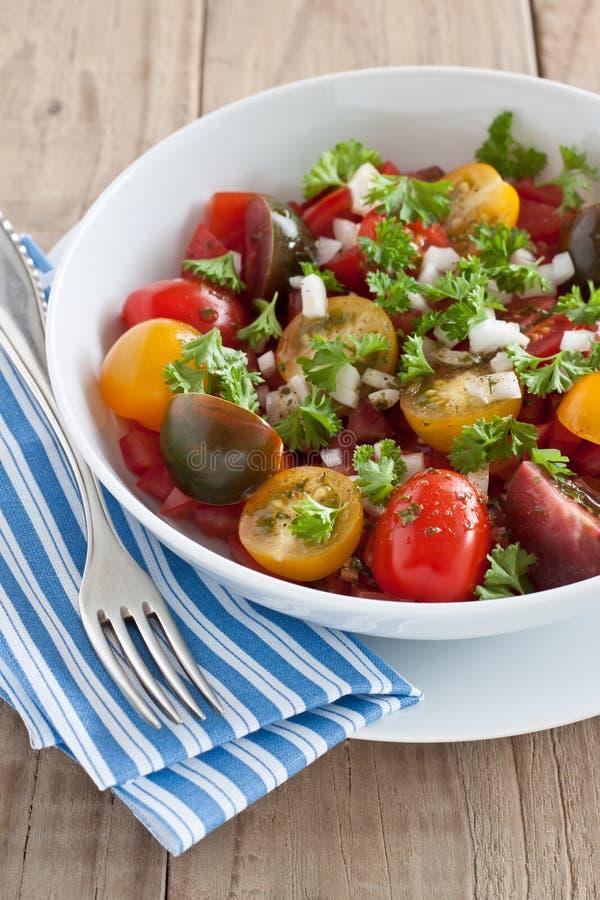 Verse tomatensalade stock afbeelding