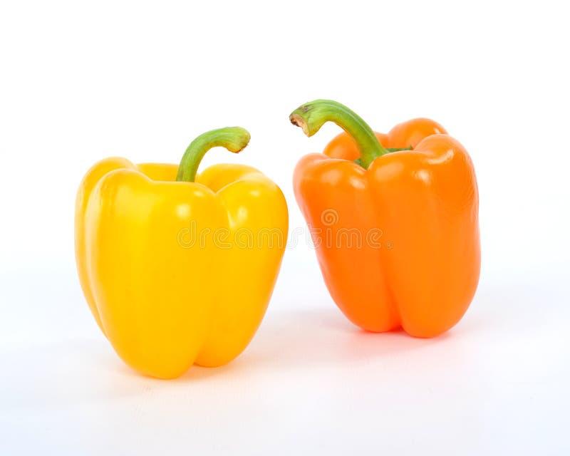 Gele en Oranje Groene paprika's stock foto