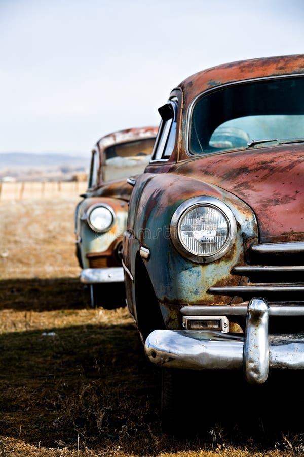 Versión de la vertical de los coches de la vendimia foto de archivo