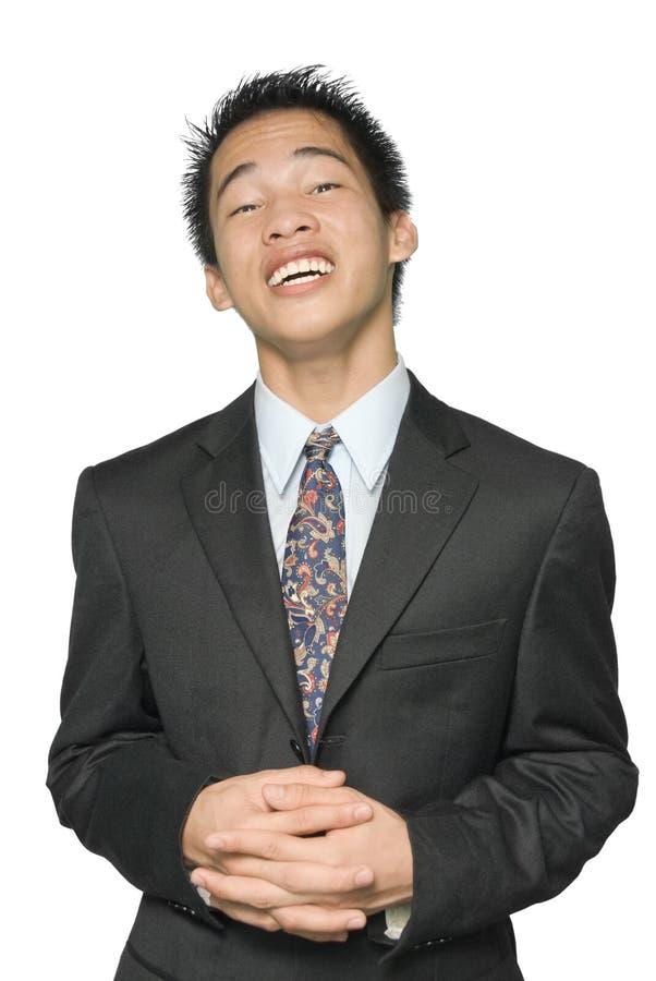 Versichernder asiatischer Geschäftsmann lizenzfreie stockbilder