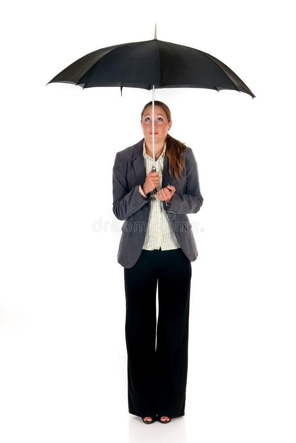 Versicherungsmittelregenschirm stockfoto