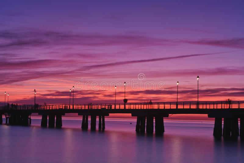 versilia захода солнца пристани Италии стоковые фотографии rf