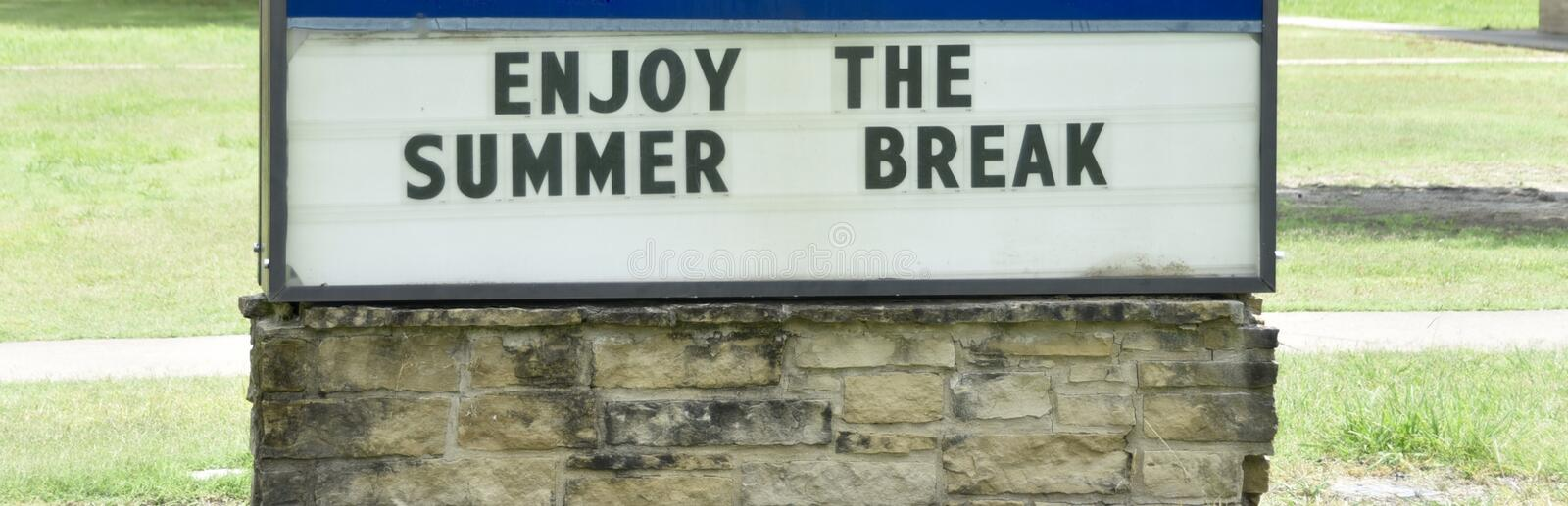 Summer Break School Sign. A sign on a school campus encourages students at a grade school, community college or university to enjoy their summer break and time royalty free stock images