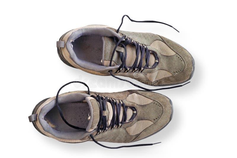 Versleten het lopen geïsoleerdeg schoenen royalty-vrije stock foto's