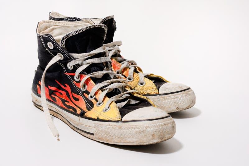 Versleten Tegenovergestelde All Star-schoenen royalty-vrije stock foto