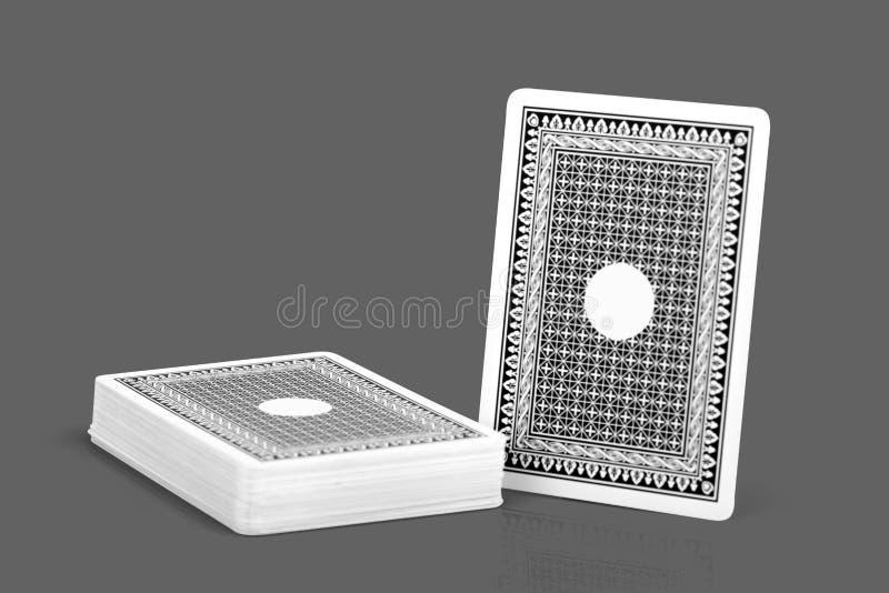 Verso da cor do preto do cartão do jogo no fundo isolado com trajeto de grampeamento foto de stock royalty free