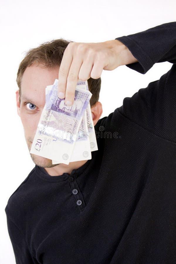 Verstecken hinter Geld stockbild