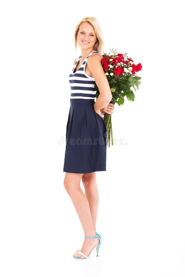 Versteckende Rosen Der Frau Stockfotografie