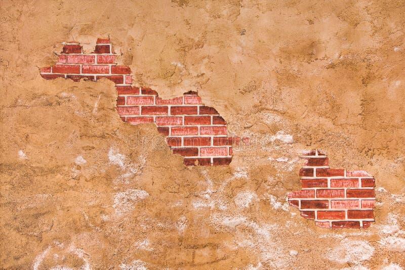 Versteckte Backsteinmauer stockbild