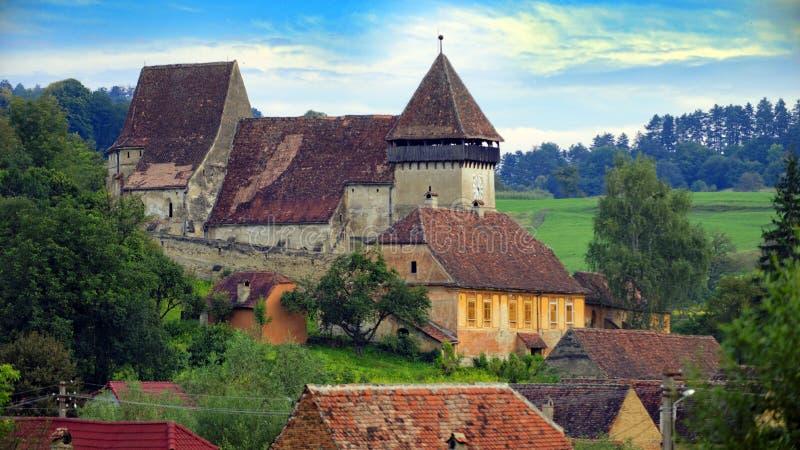 Versterkte kerk, Copsa-Merrie, Transsylvanië, Roemenië stock foto's
