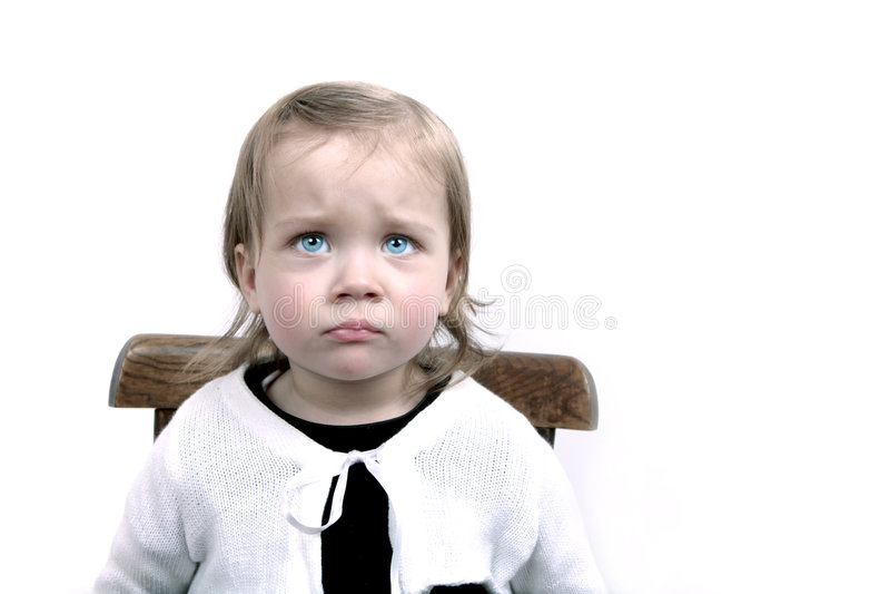 Verstoord babymeisje stock foto