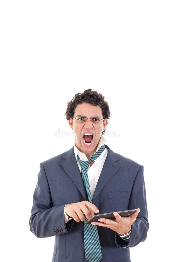 Verstoord en boos van de vermoeide mens in de tablet van het kostuumgebruik voor het werk royalty-vrije stock afbeelding