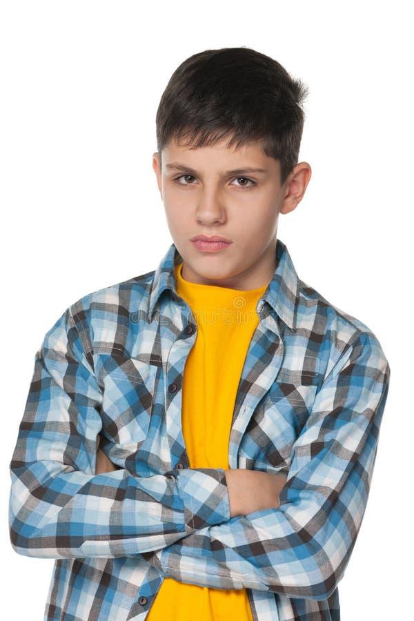 Verstoorde tiener in een gecontroleerd overhemd stock afbeeldingen