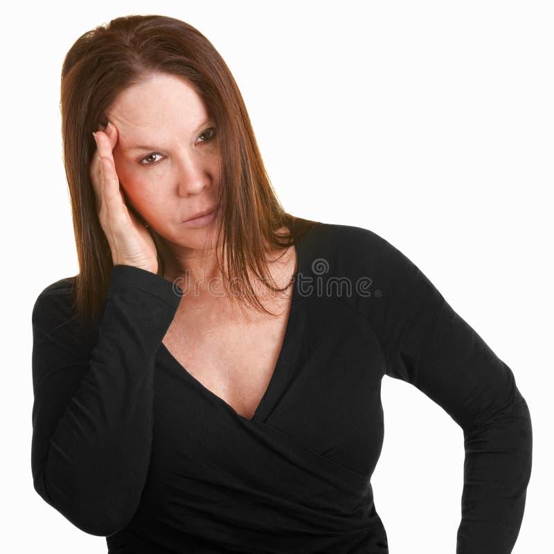 Verstoorde Vrouw met Hand op Hoofd stock fotografie