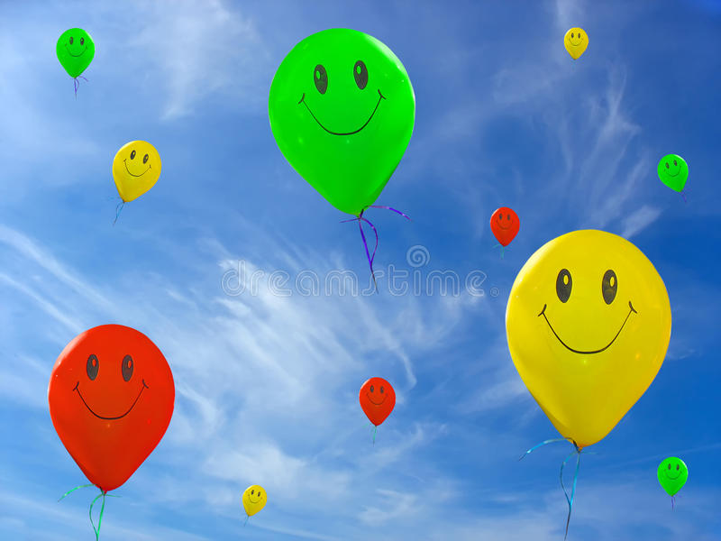 Vert de sourire, ballons jaunes rouges photos stock