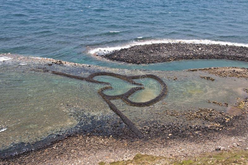 Vertedero de marea de la piedra gemela de los corazones en Chimei Taiwán fotos de archivo libres de regalías
