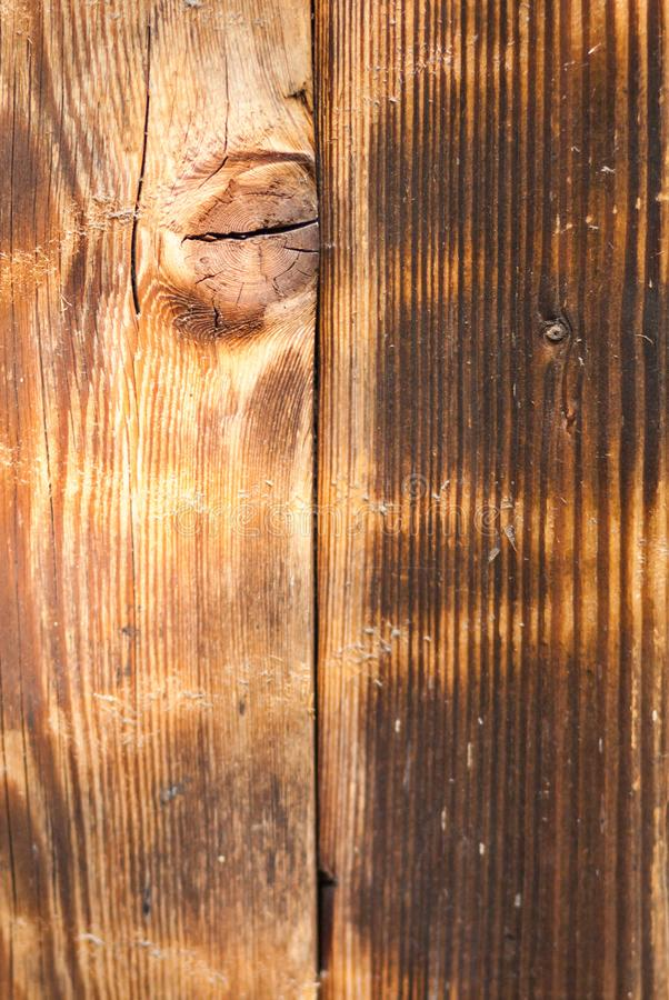Vertical abstract background of a shabby wooden surface of light. Brown color with beautiful patterns of natural lines and circles royalty free stock image
