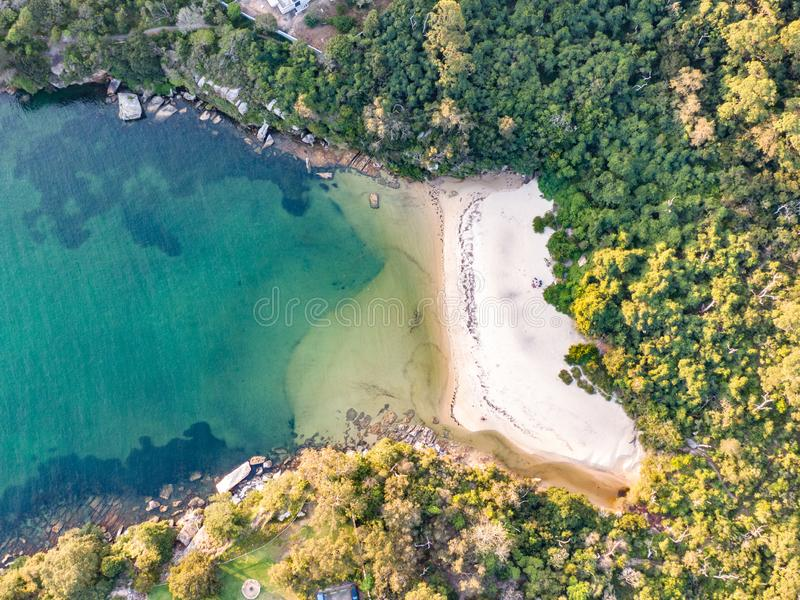Vertical aerial drone view of Collins Flat Beach, part of Sydney Harbour National Park. stock image