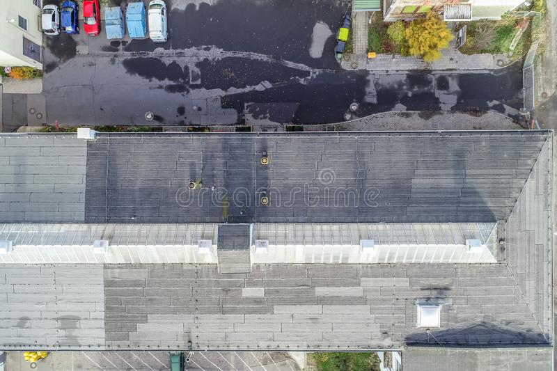 Vertical aerial photograph of an old industrial hall with a glass roof in the Firste, drone photograph.  royalty free stock photos