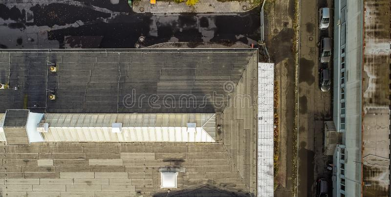 Vertical aerial photograph of an old industrial hall with a glass roof in the Firste, drone photograph.  stock image